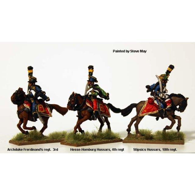 Hussars, full dress, swords shouldered, galloping